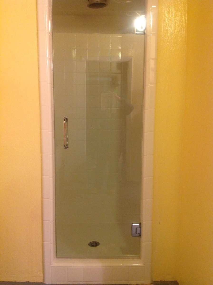 Photo Single Shower Door Heavy Clear Glass Installed In