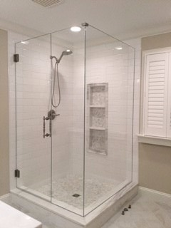 Freestanding corner shower w/ low iron glass and Portals handle