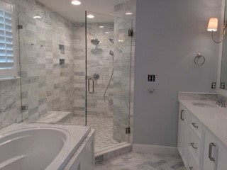 Seamless all glass neo angle shower with marble tile in Chapel Hill NC